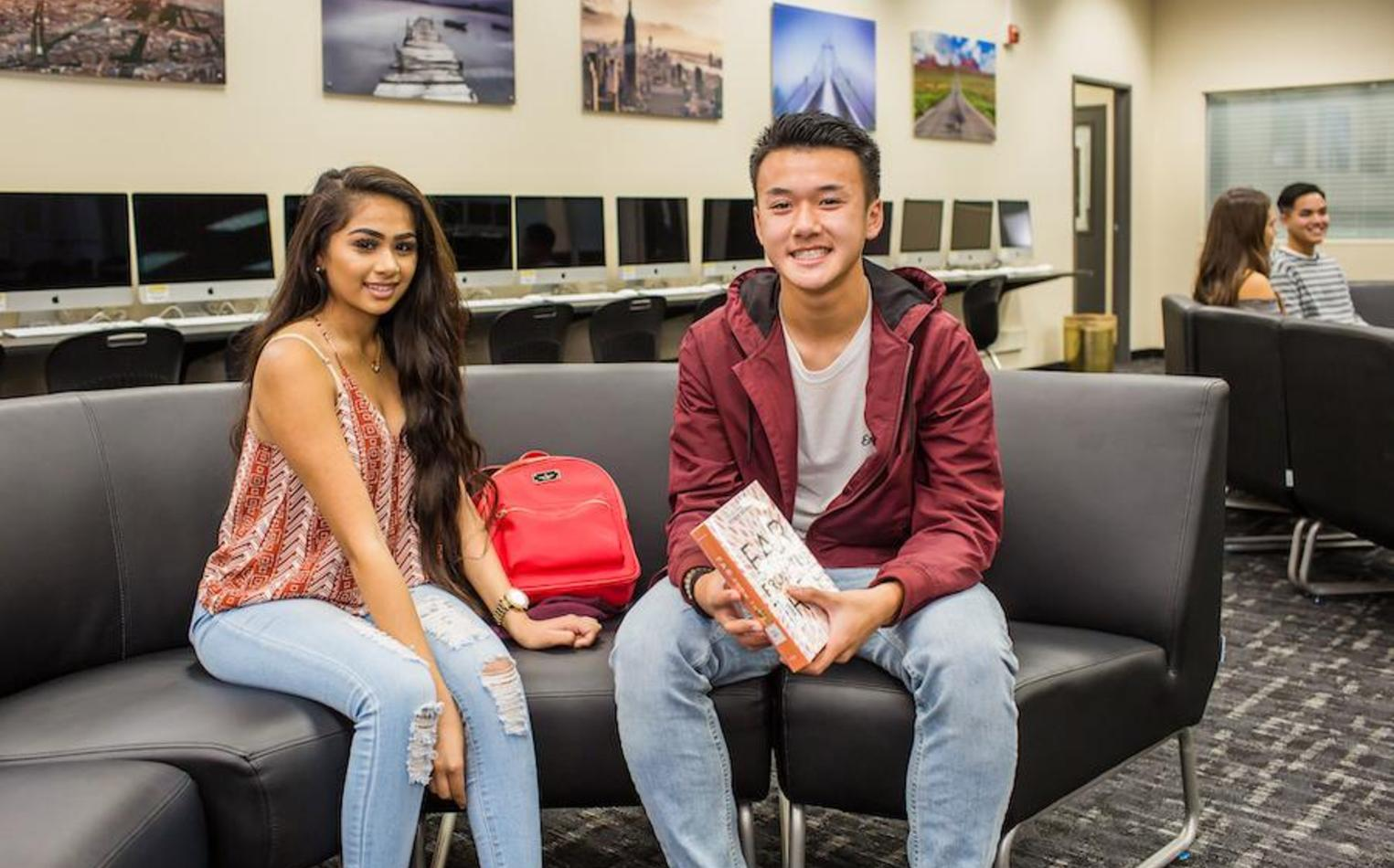 Two students sitting in library.