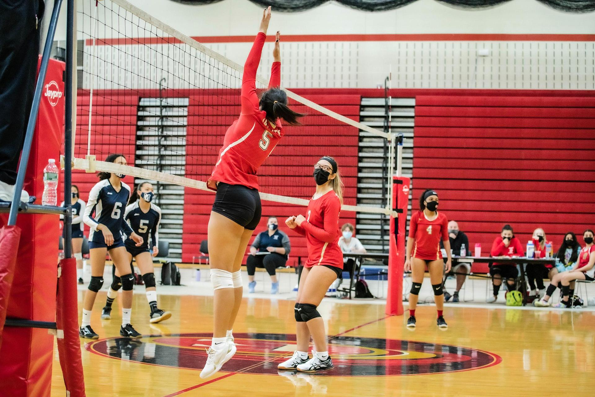 A player leaps to block a shot