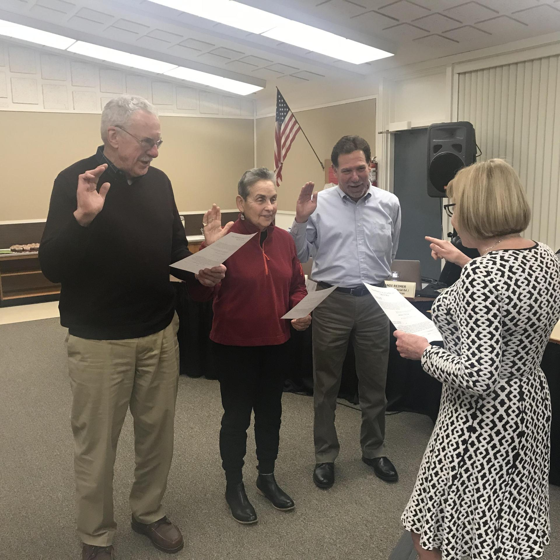 George Wylie, Gail Levine, Mark Becker take their oath of office