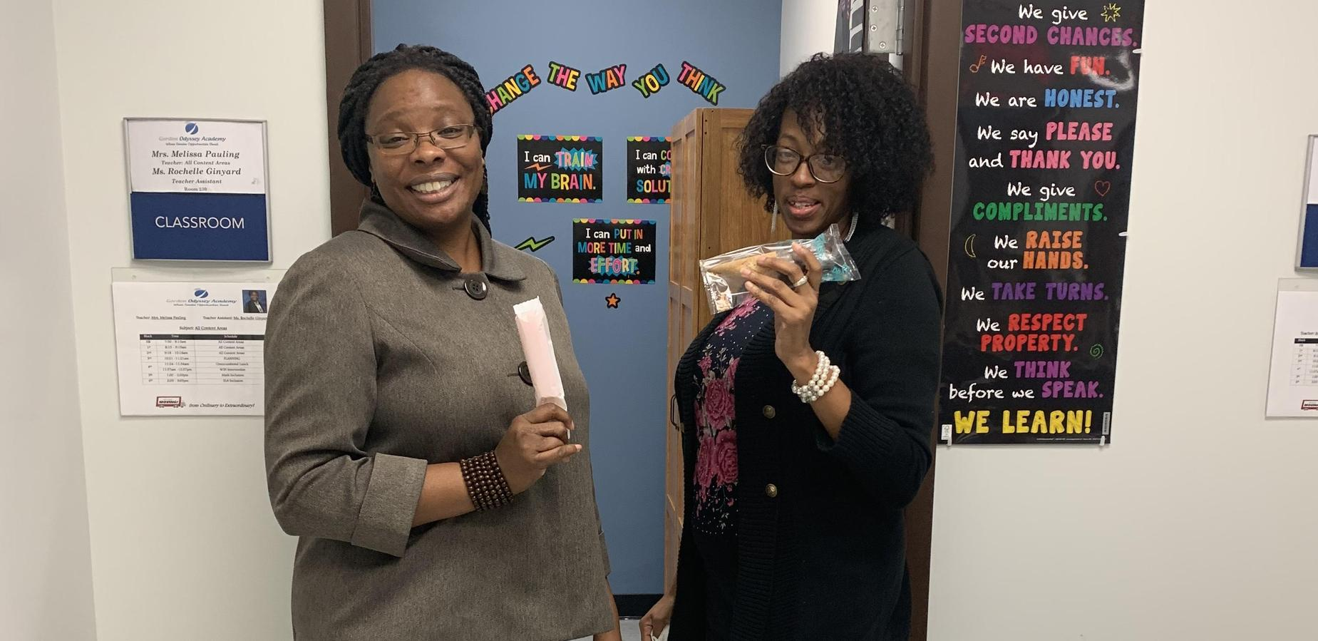 Mrs. Pauling and Ms. Ginyard enjoying a treat during American Education Week