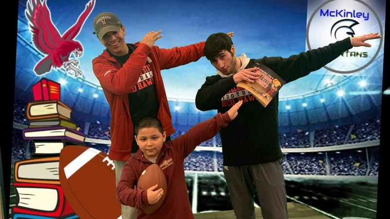 players dabbing with students