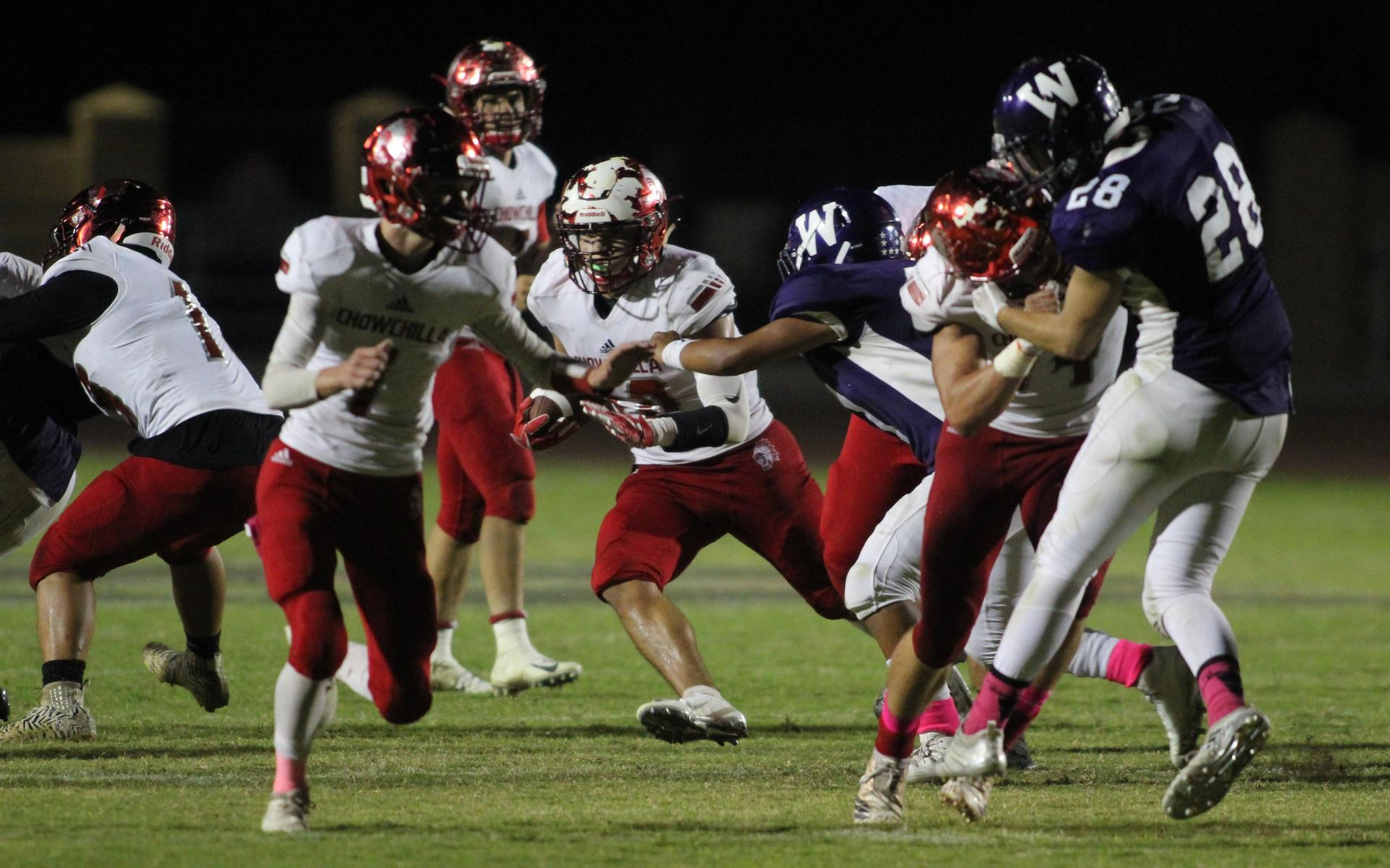 Varsity Football players in action against Washington Union