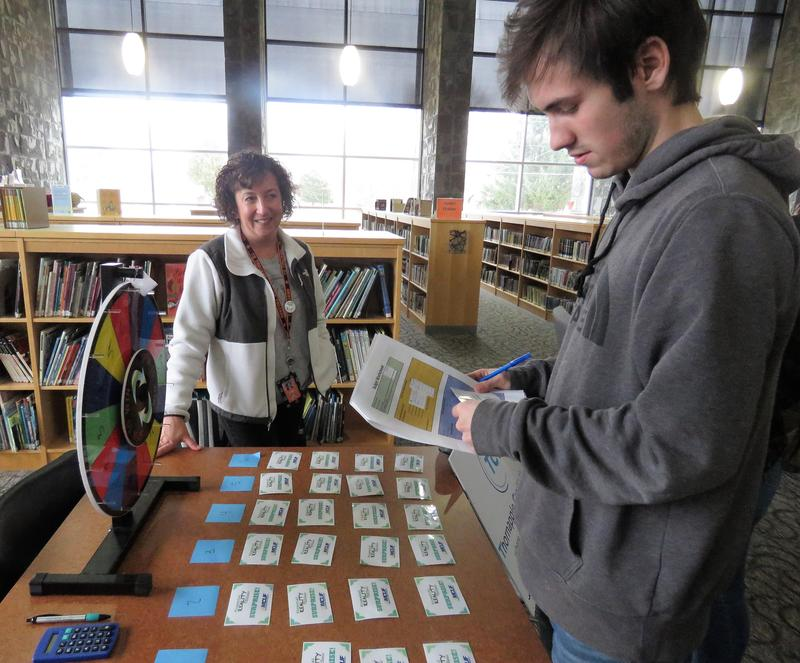 A TKHS student takes a spin on the Wheel of Reality to see if he's scored good luck or faces an unexpected expense.
