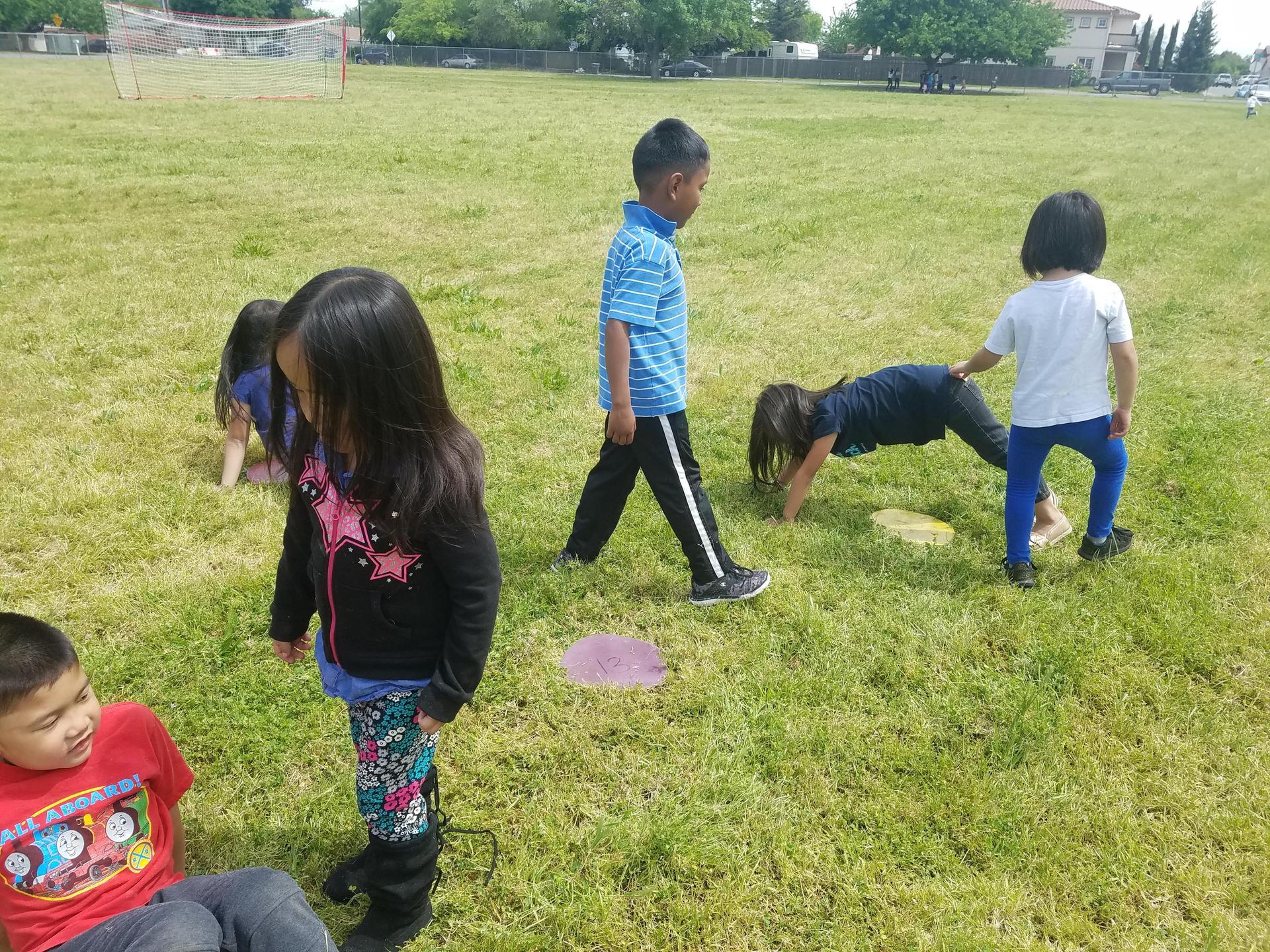 Kindergarten class exercising with 'flip flop'