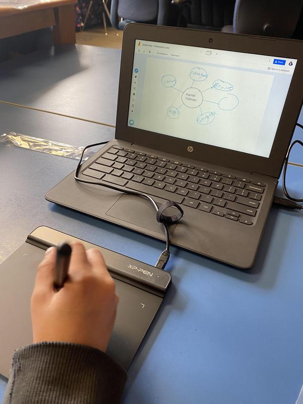 student using pen