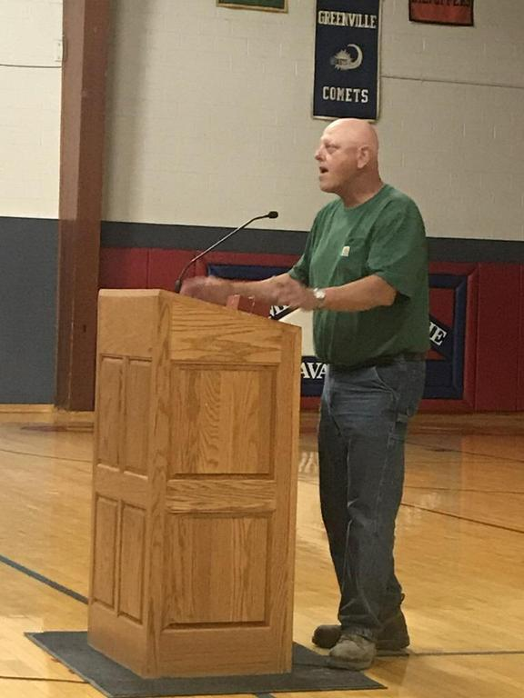 Jon Klaus speaking at the podium