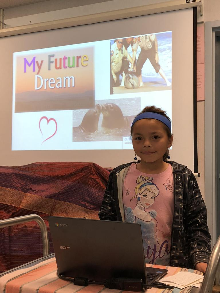 "Student picture with a presentation slide ""My Future Dream"" in the back"
