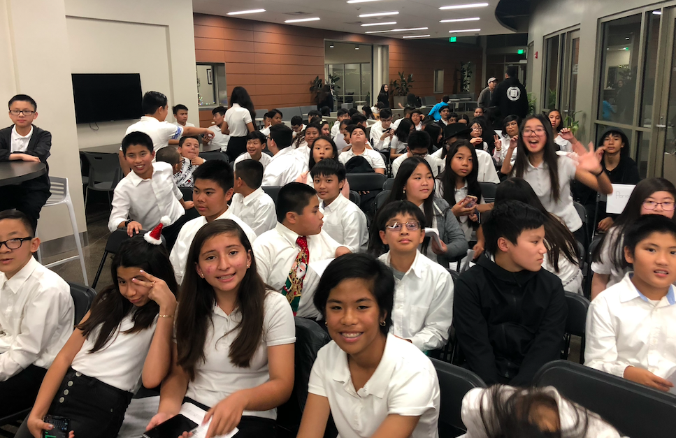 CCA students dressed in white shirts for the 2019 Winter Concert.