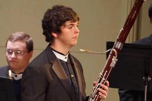 Caleb with his bassoon during a concert
