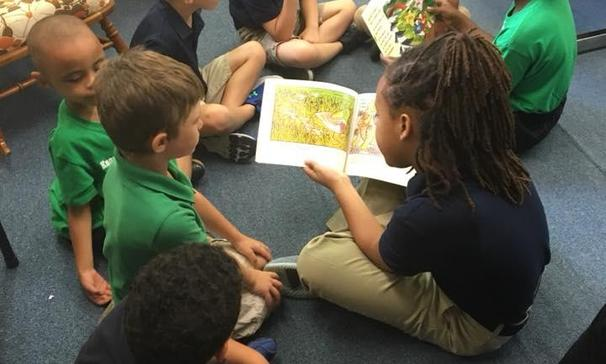 FOURTH GRADERS READ TO KINDERGARTEN STUDENTS