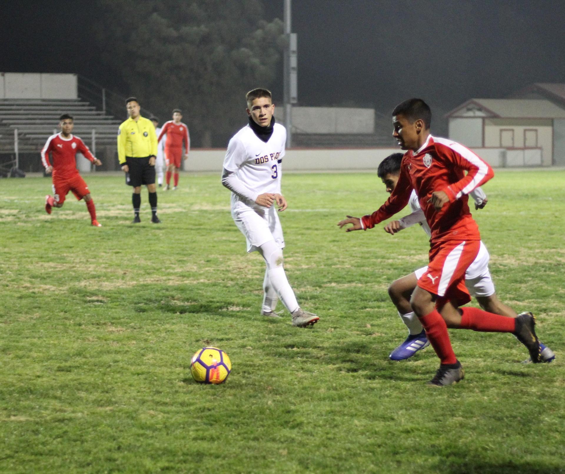 Cesar Galvan running towards the ball