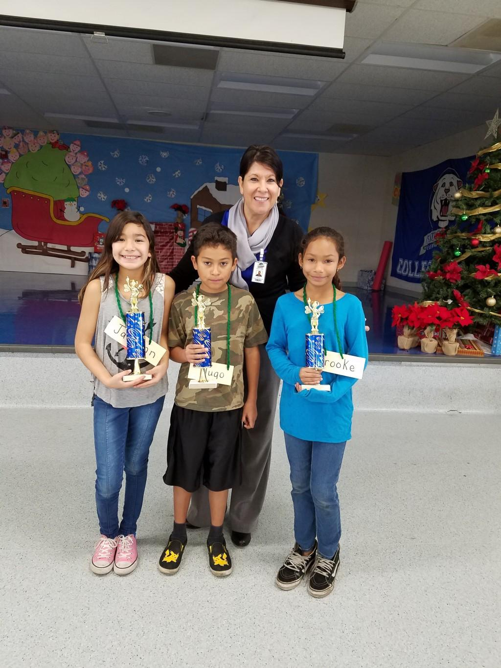 Students with their award, posing with Principal Inielda Luna