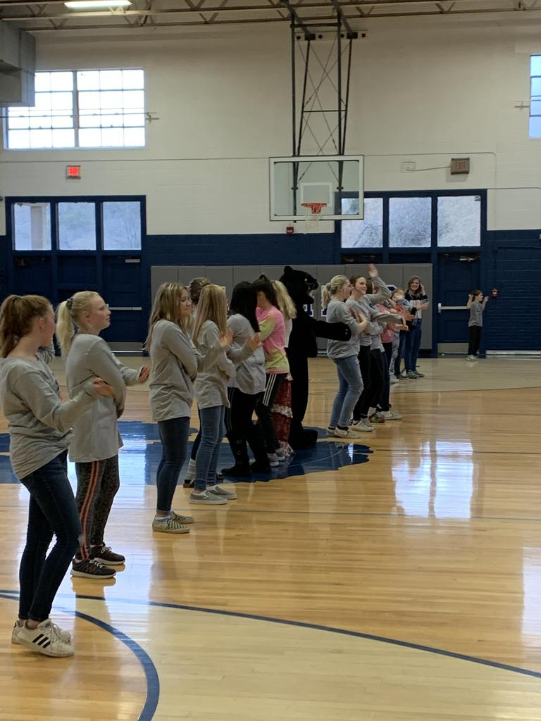 NMS students dancing in the gym.