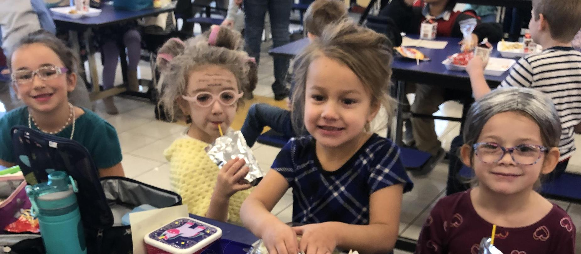 girls dressed as 100 year old