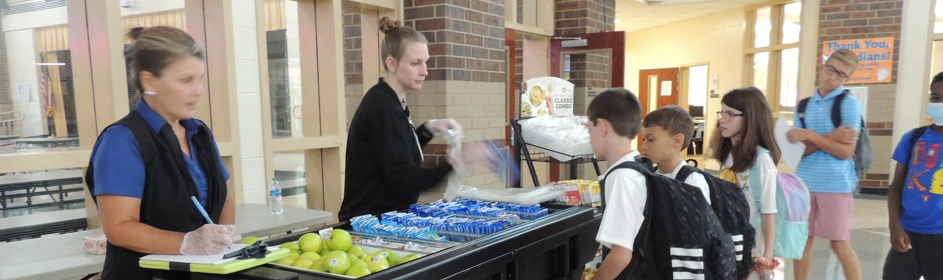 Students getting breakfast in the commons area at Westview.