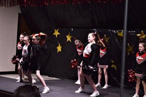 Cheerleaders on stage.