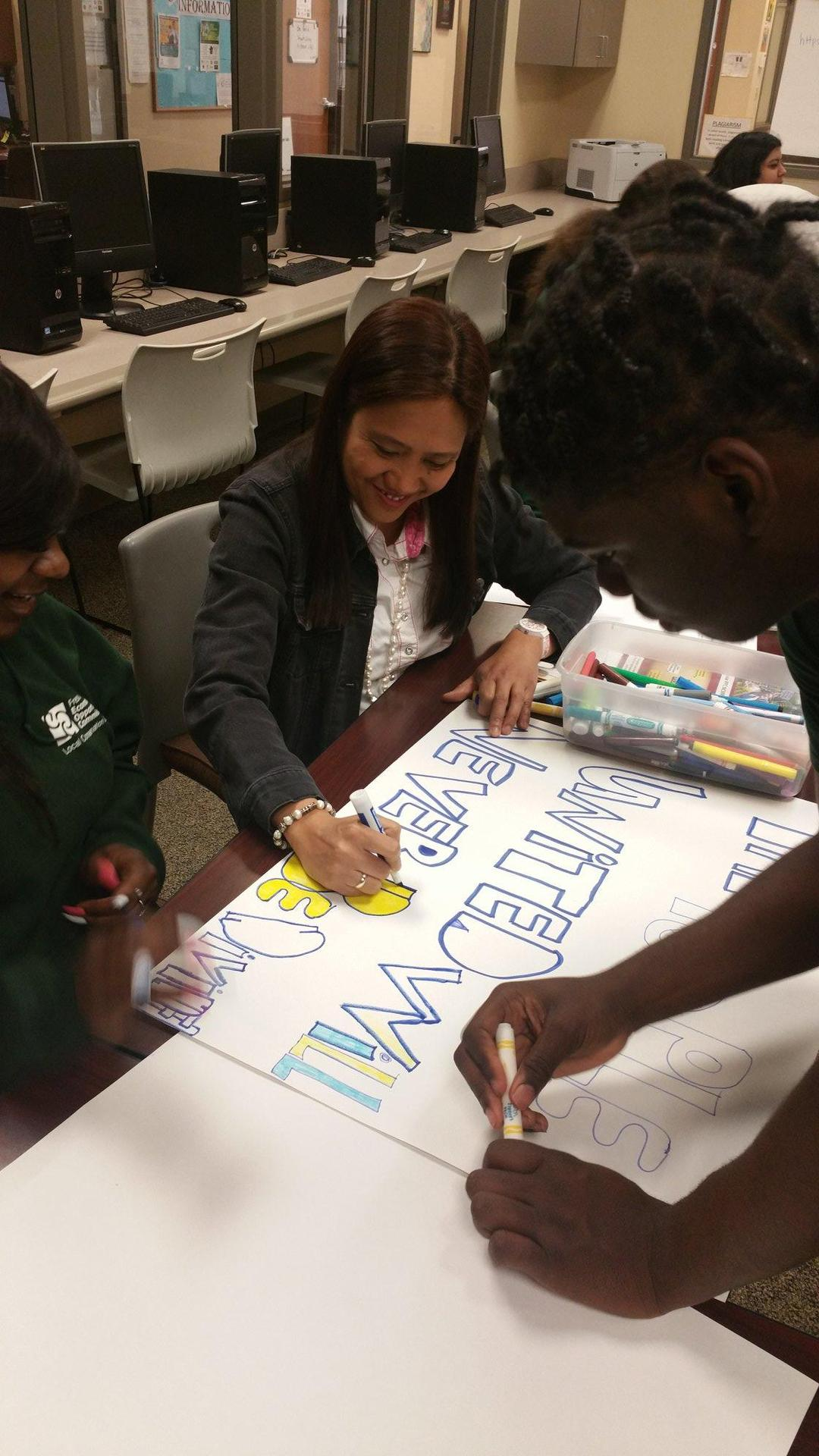 students decorating signs