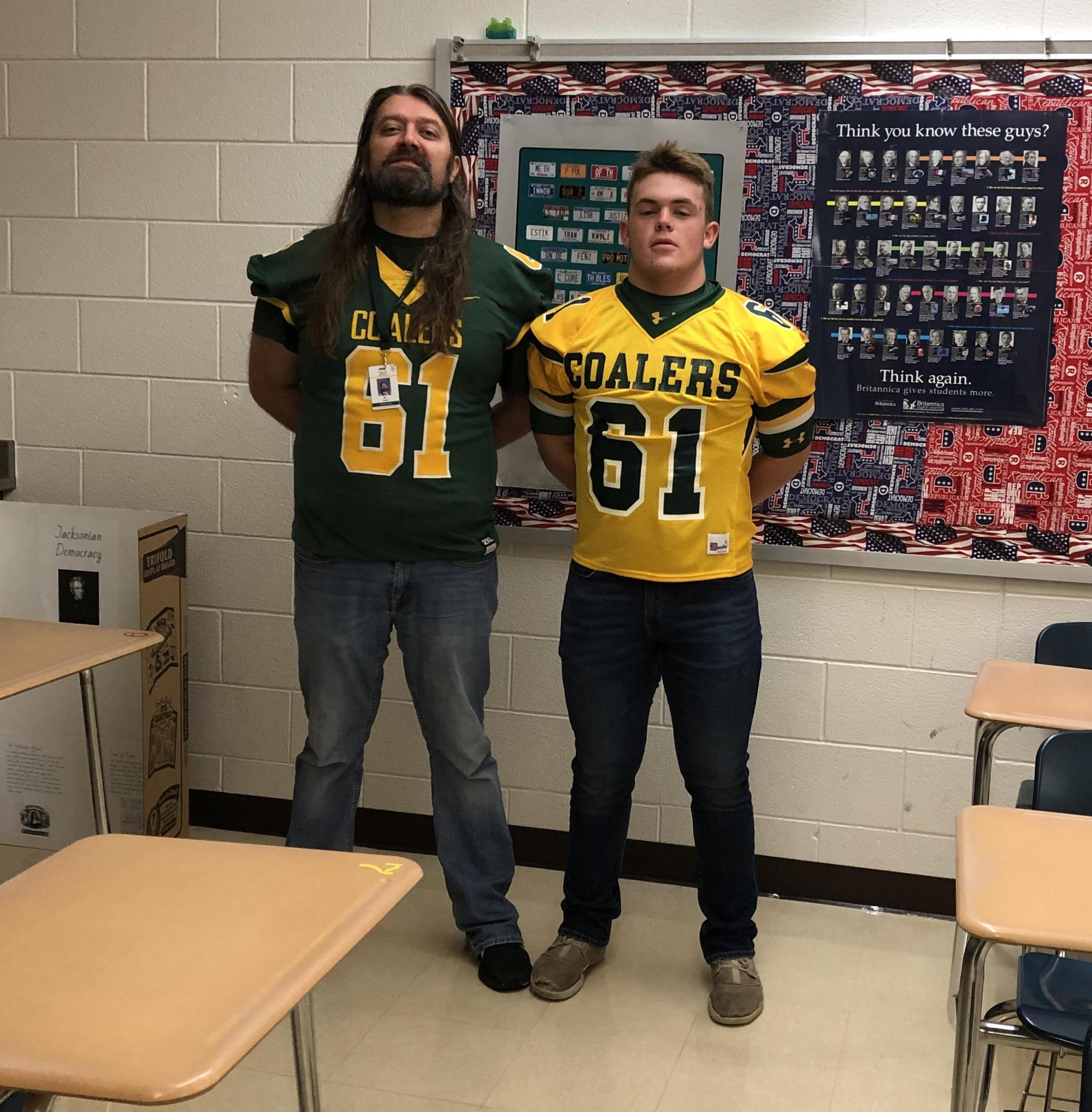 mr. baer with a football player. they are wearing the same coaler jersey.