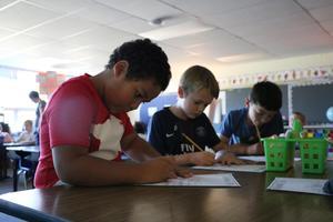 Ms. Elliott's class working on an assignment!