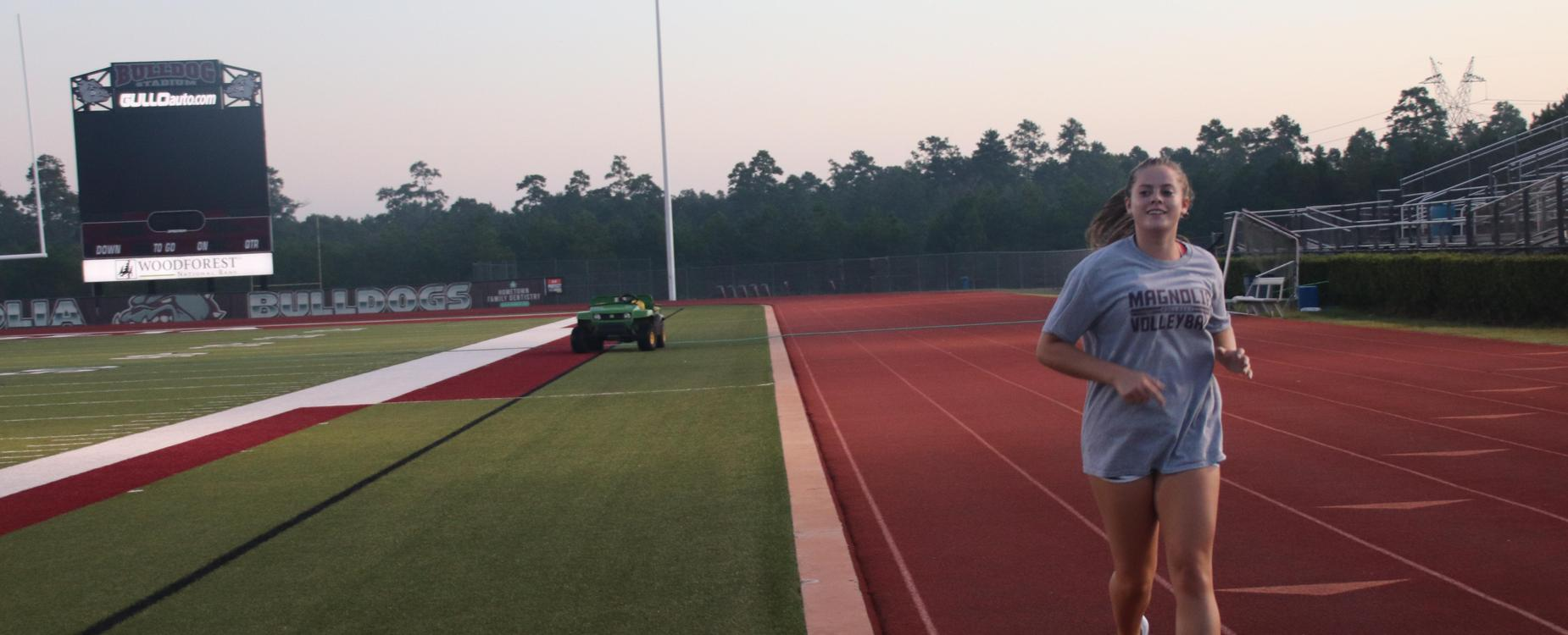 Student running on the track