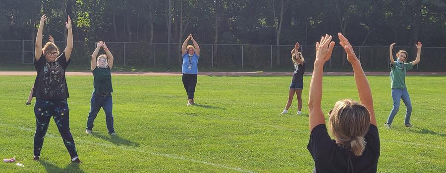 Life Skills class doing yoga outside.