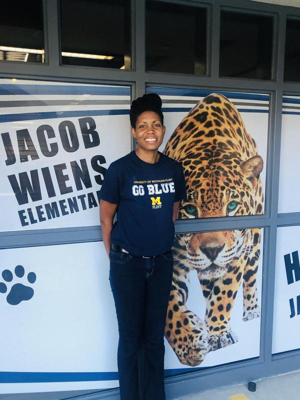 Candyce Lewis in front of a Jacob Weins sign