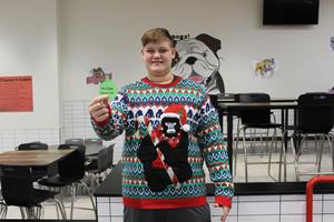 Ugly Sweater Contest Madness Champion Featured Photo