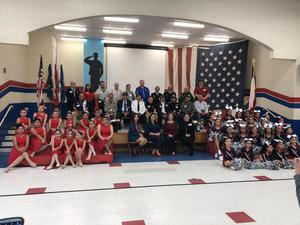 veterans posing with student groups and admin.