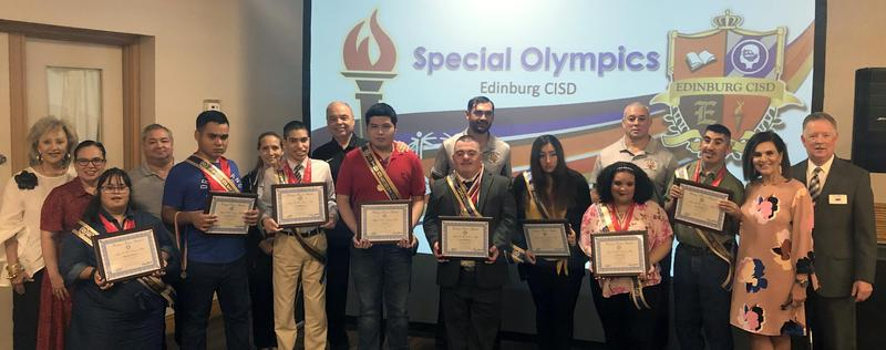 Student athletes from the Edinburg CISD Special Olympics Program are pictured holding their awards during an Edinburg Rotary Club meeting at the Echo Hotel in Edinburg.