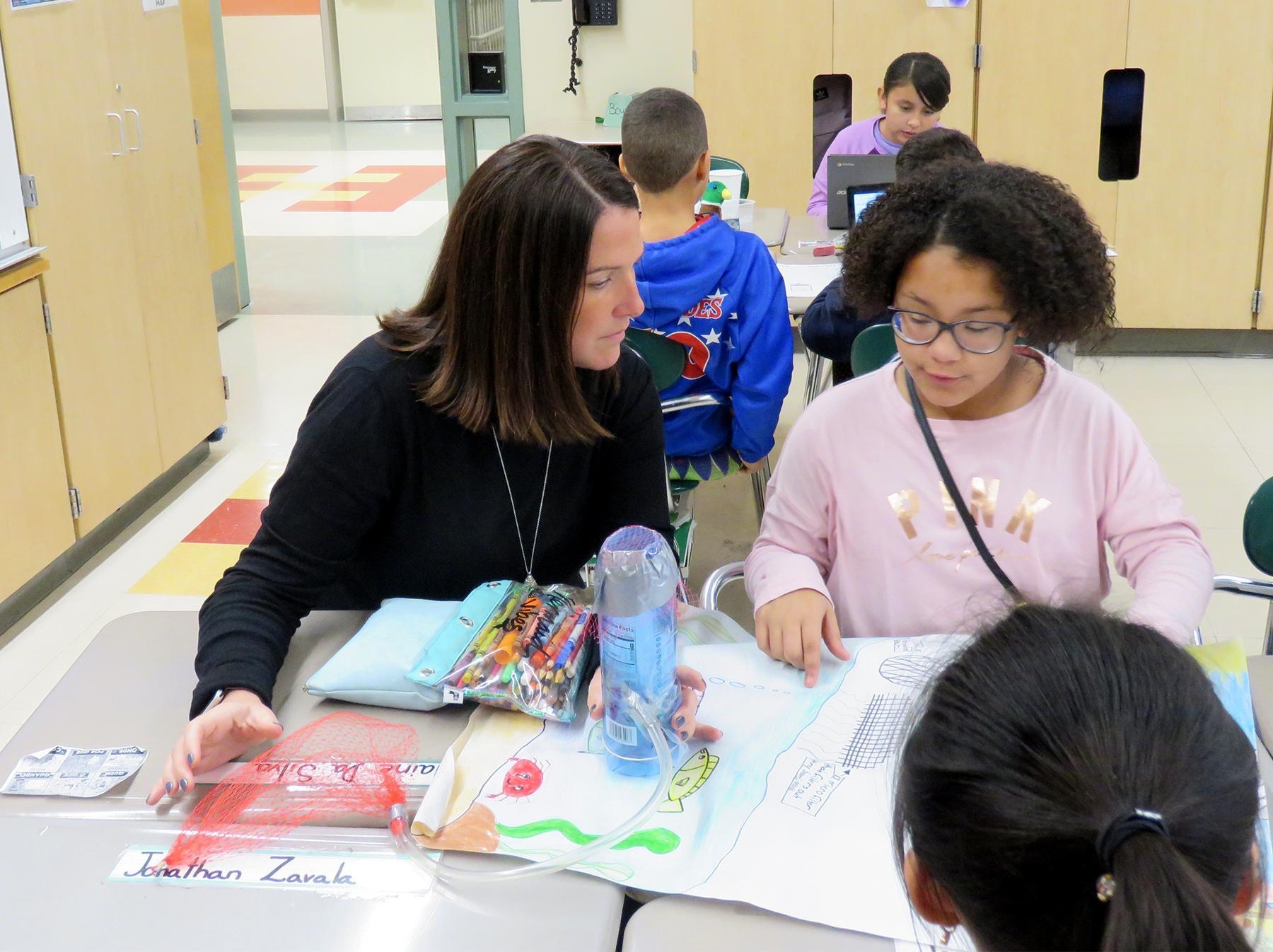 Curriculum Director Michelle Crowell and a student