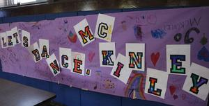 hoto of sign at 8th Annual McKinley-Thon when students and staff dance to raise money for pediatric cancer research.