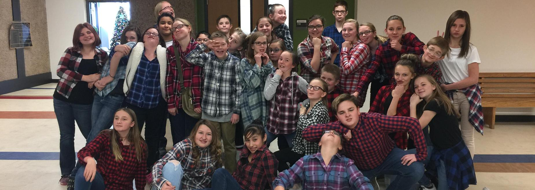7th Grade wearing plaid doing crazy poses
