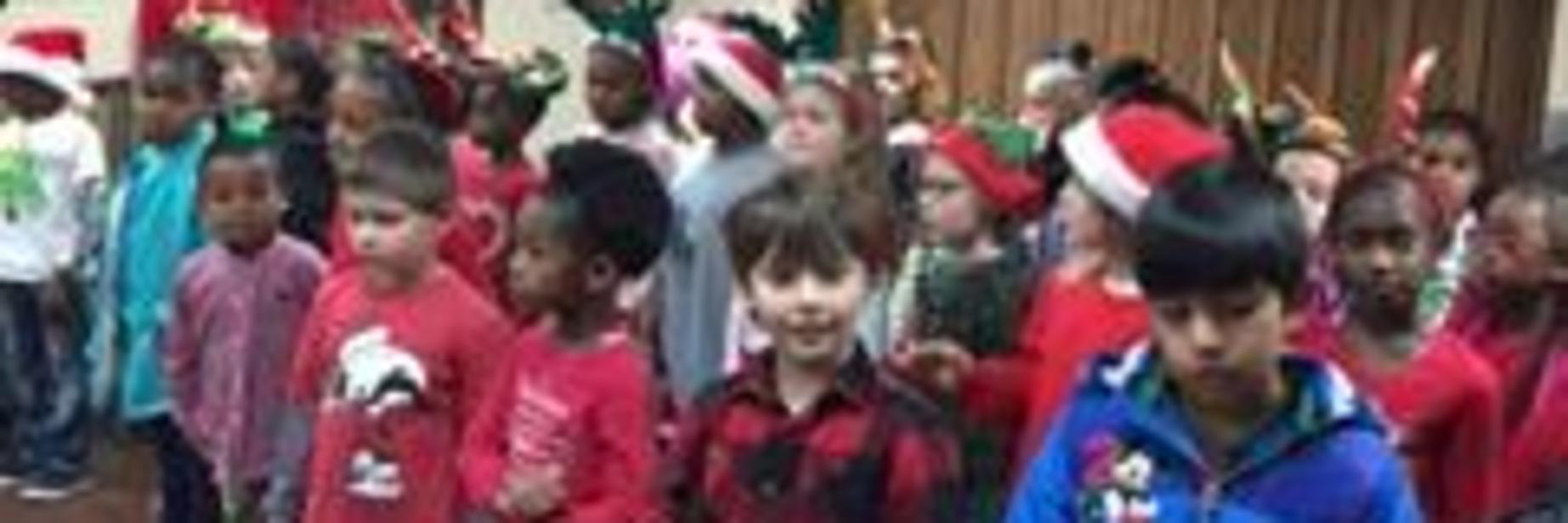 First graders caroling