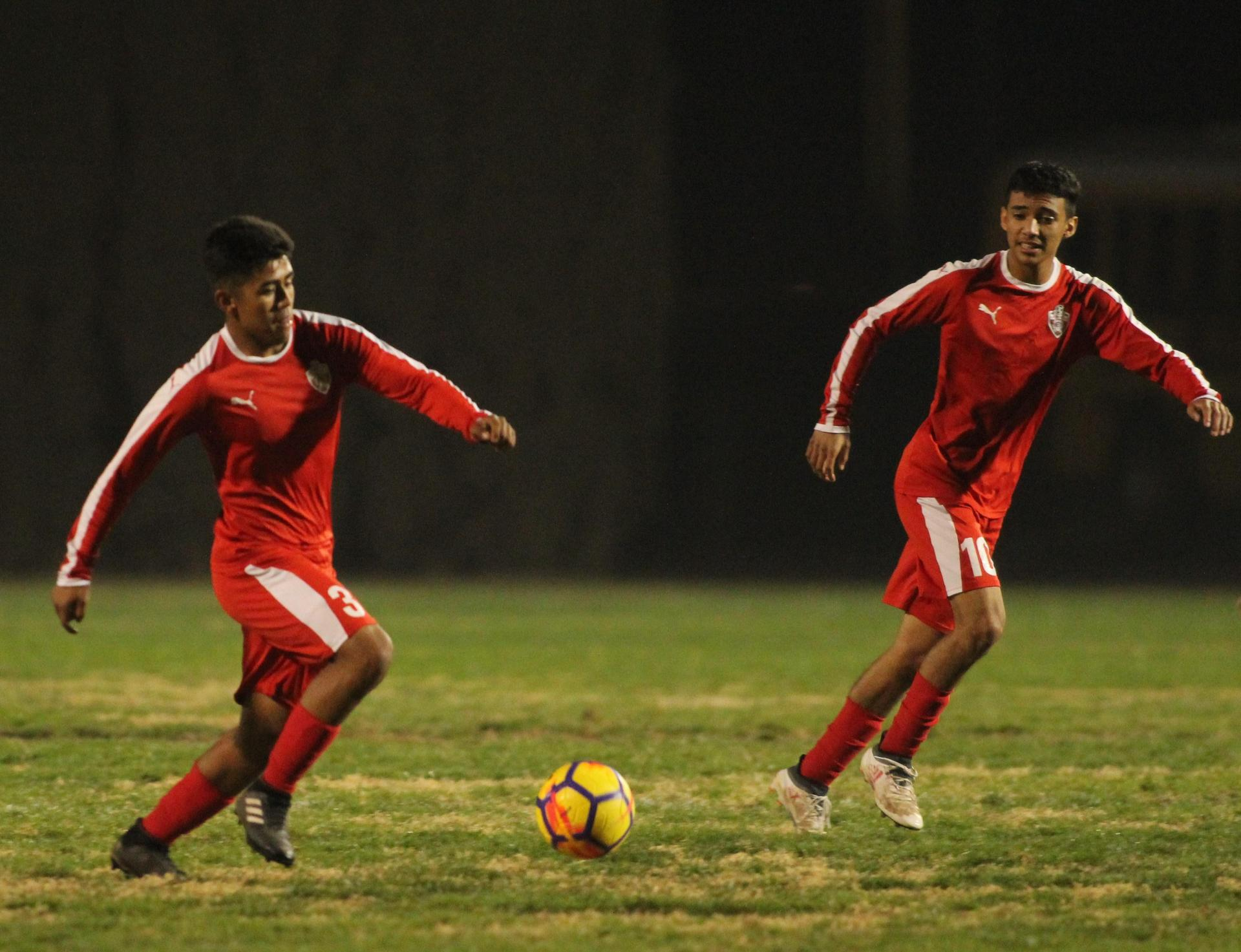 Alejandro Montes and Jacob Corchado Running with the Ball