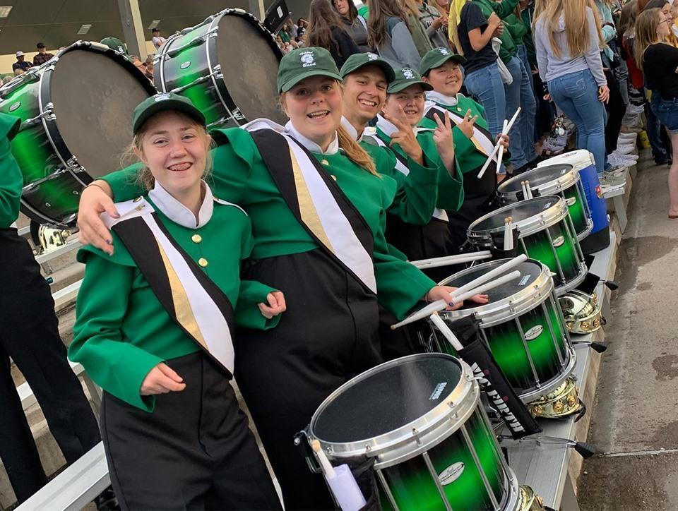Drum section of band posing for photo
