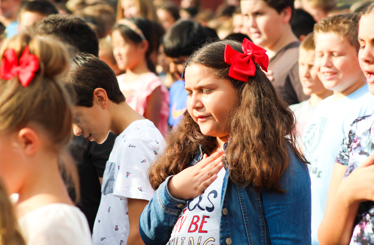 A student reciting the Pledge of Allegiance.