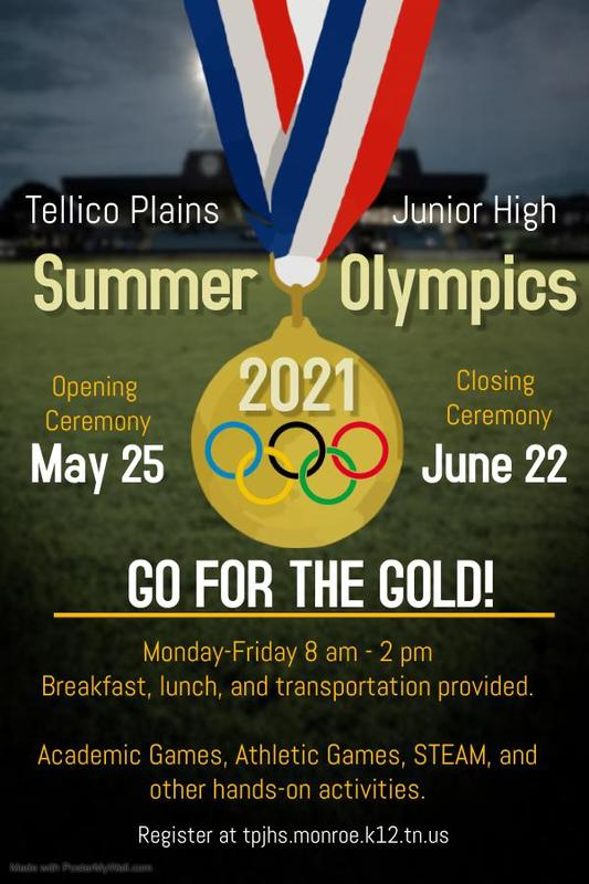 gold medal with olympic rings on athletic field background