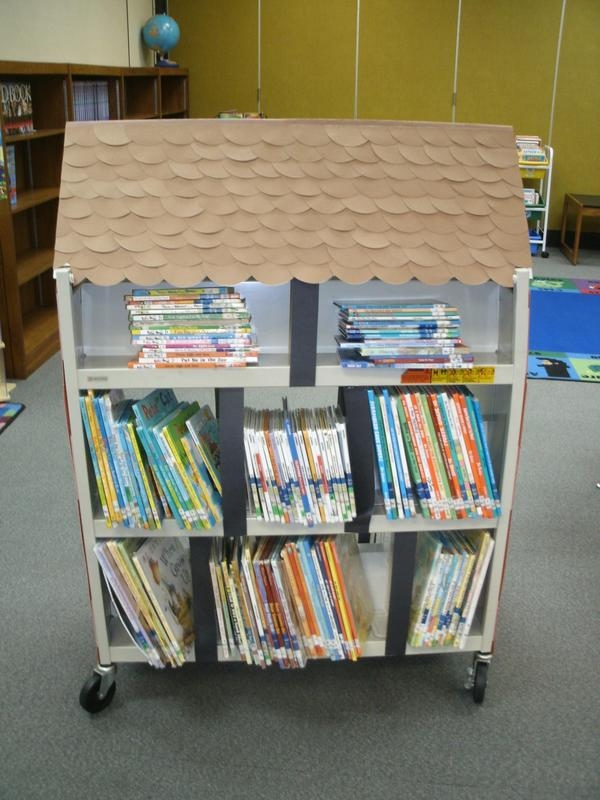 Book cart with library books.