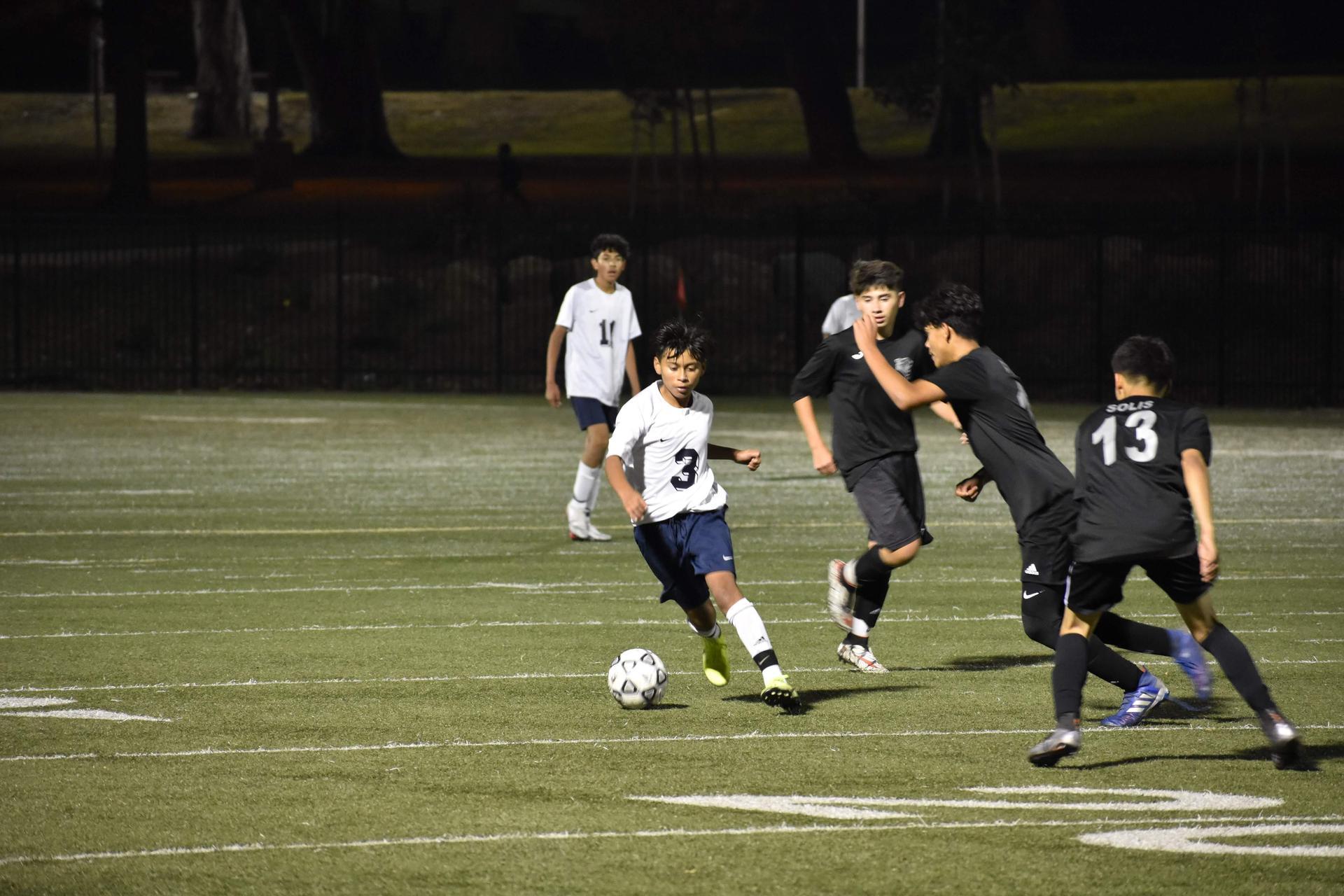 Jaguars Midfielder Julio Portillo dribbling around defenders vs Triumph Charter