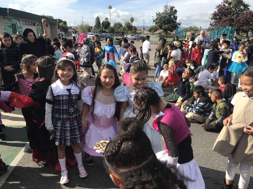 Group of students dressed in costume smiling