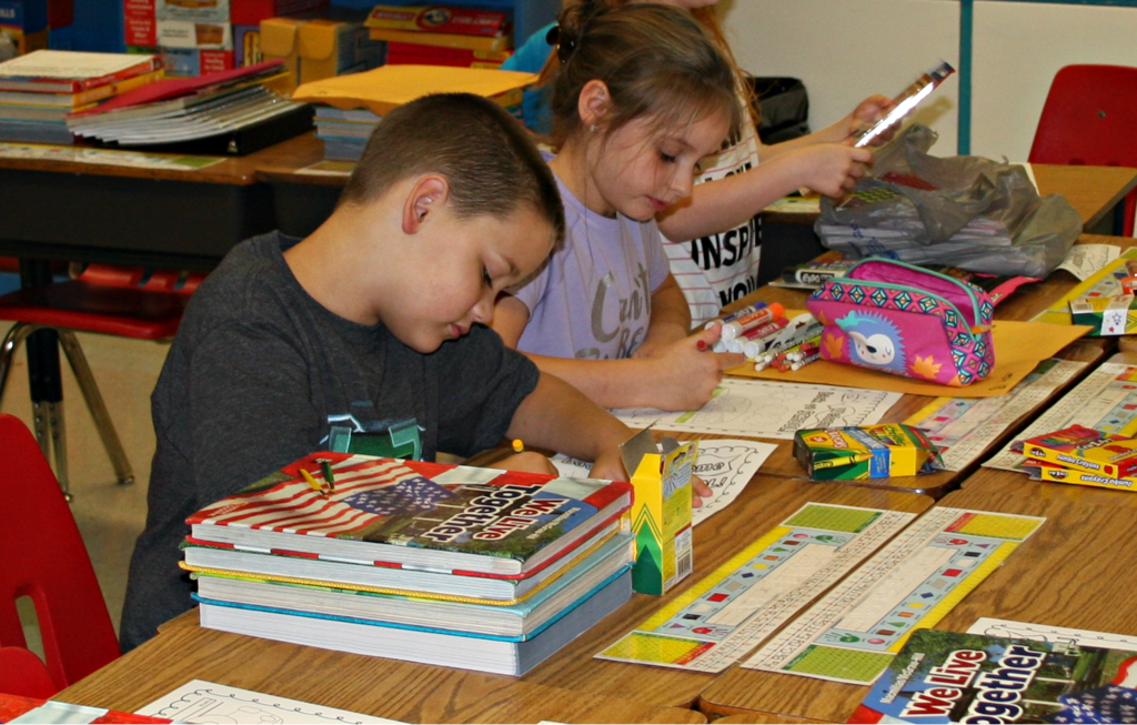 Students work at their desks on the first day of school at C.B. Eller Elementary.
