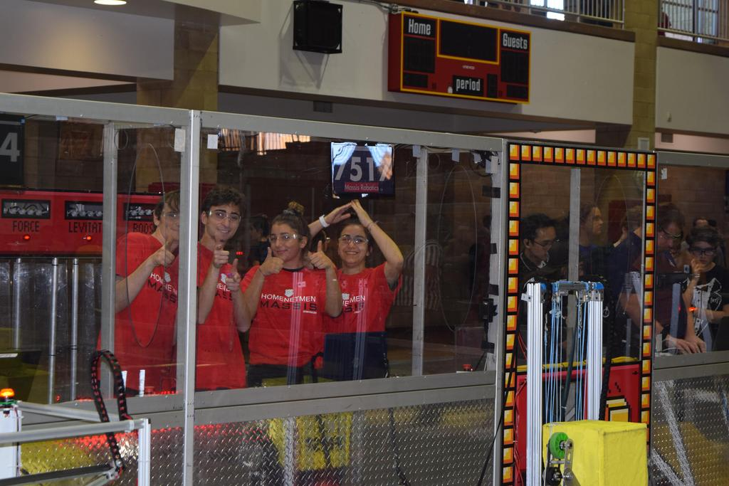 7515 (our practice bot) drive team posing before a match