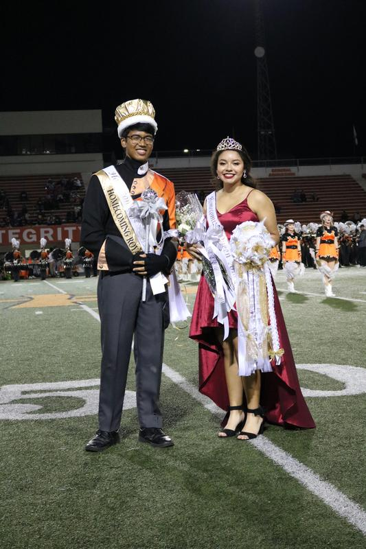Male and female students smiling after being named Homecoming King and Queen