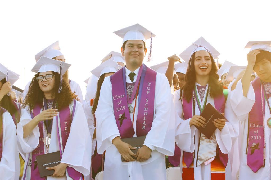 graduates cheering