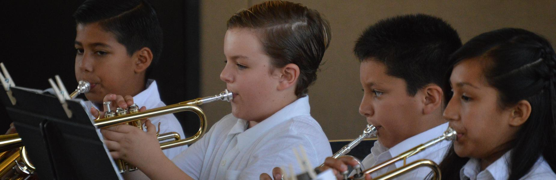 Elementary Band Trumpet Players Performing