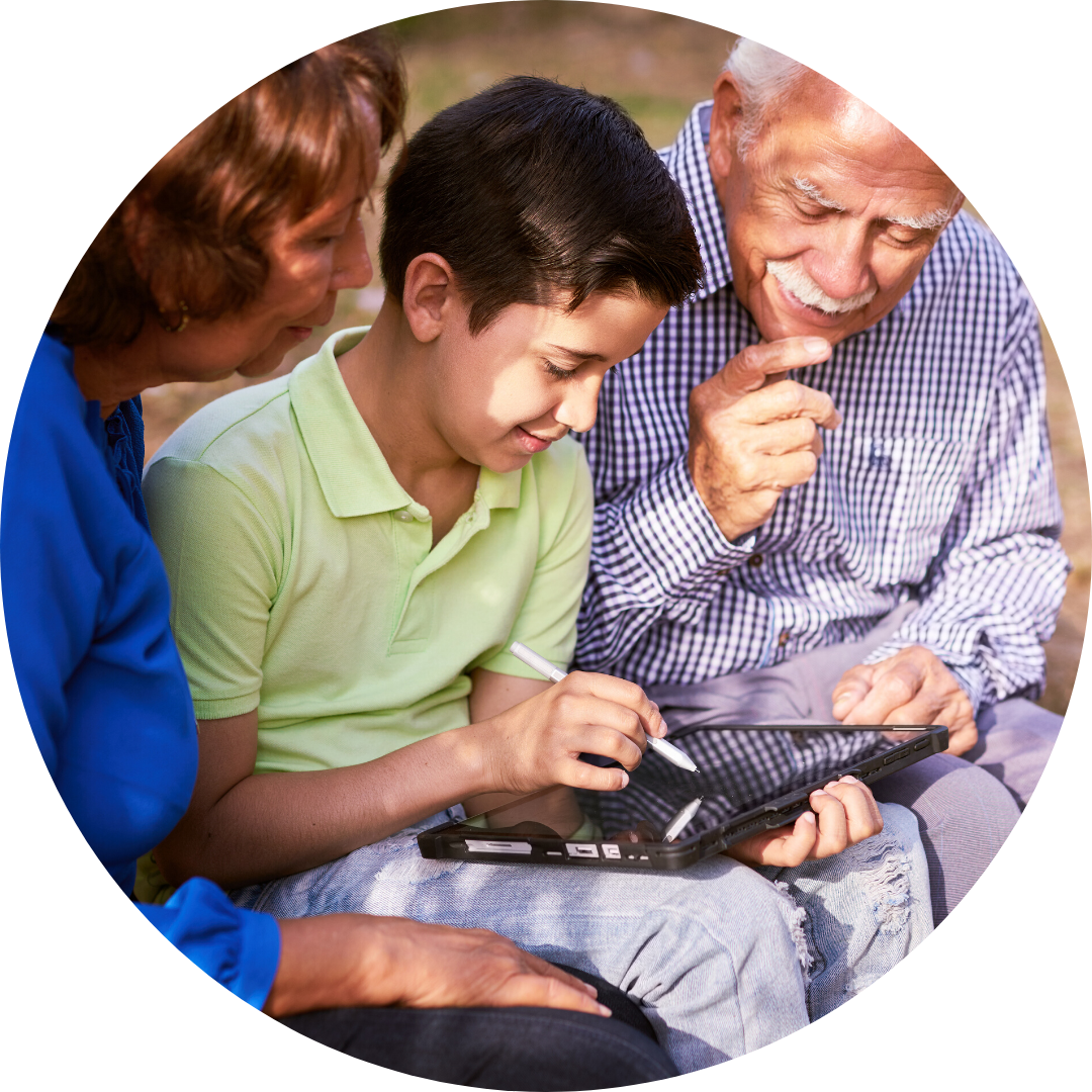 grandparents and grandson looking at ipad together