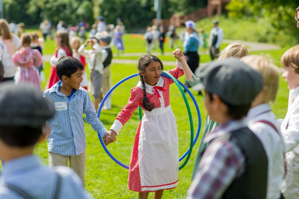 Students playing hula hoop game