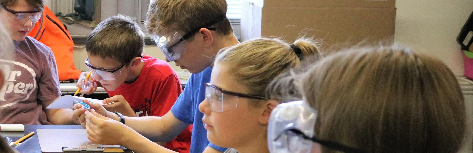 CSI sleuths study clues and evidence at STEM Camp.