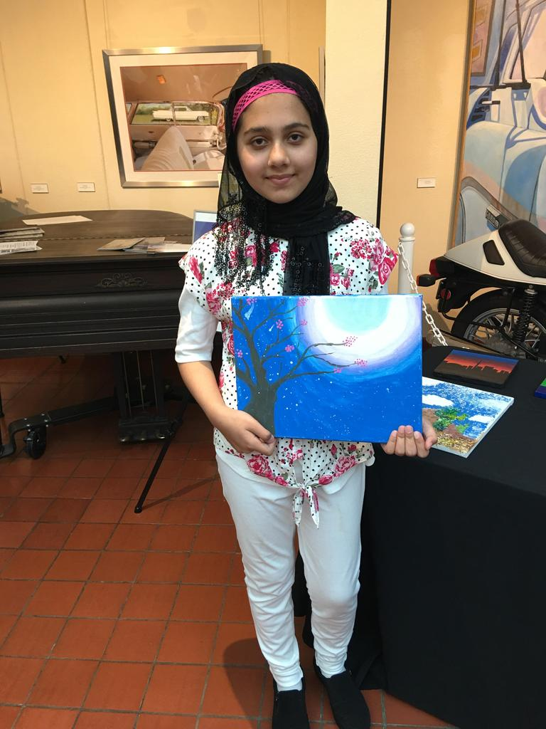 Juliette Low School of the Arts Student displaying their artwork.