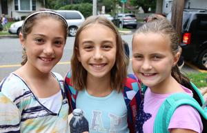 Three McKinley School students pose for a picture during first week of school.